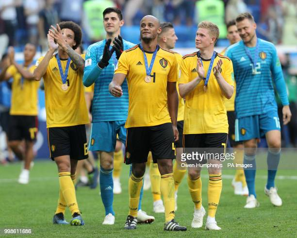 Left to right Belgium's Axel Witsel Thibaut Courtois Vincent Kompany and Kevin De Bruyne celebrate with their medals after the FIFA World Cup third...
