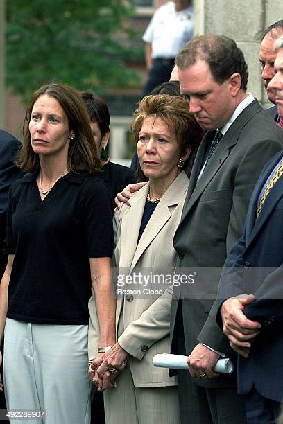 Left to right Belinda Markel daughter of Ilse Stark center and Asst District Attorney Rick Grundy stand together during a press conference on June 29...