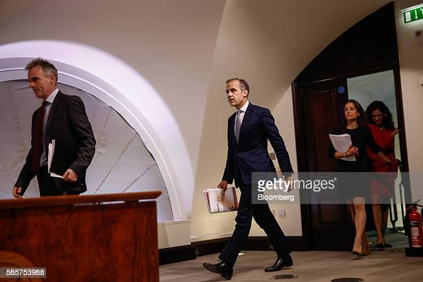 Left to right Ben Broadbent deputy governor for monetary policy at the Bank of England Mark Carney governor of the Bank of England Jenny Scott...