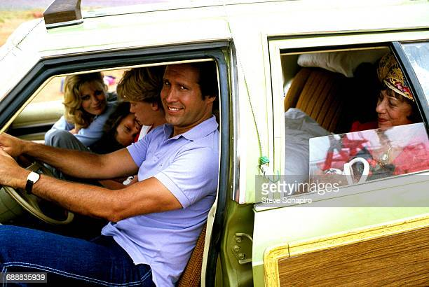 Left to right Beverly D'Angelo Dana Barron Anthony Michael Hall Chevy Chase and Imogene Coca are seated in a station wagon in a scene from the film...