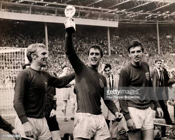 Bobby Moore, Geoff Hurst and Martin Peters following England's 4-2 victory over West Germany in the FIFA World Cup Final at Wembley Stadium in London...