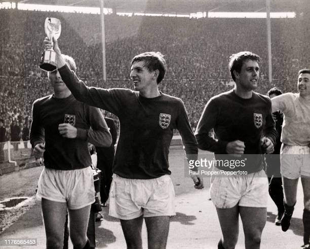 Bobby Moore Martin Peters and Geoff Hurst following England's 42 victory over West Germany in the FIFA World Cup Final at Wembley Stadium in London...