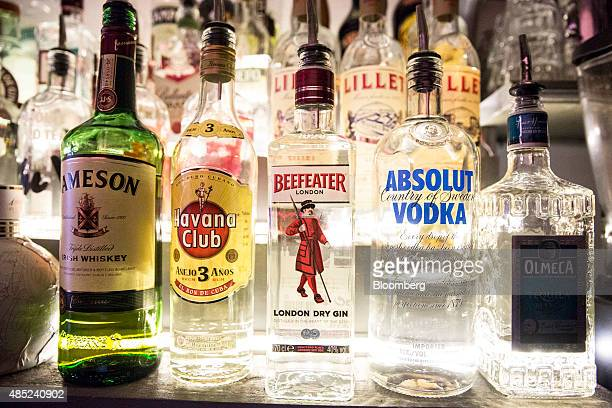 Left to right bottles of Jameson Irish whiskey Havana Club rum Beefeater gin Absolut Vodka and Olmeca tequila all produced by Pernod Ricard SA sit on...