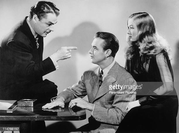 Brian Donlevy Alan Ladd and Veronica Lake in a scene from Stuart Heisler's remake of 'The Glass Key' 1942 The film is based on the detective novel by...