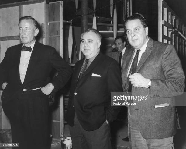 British author and creator of James Bond Ian Fleming with coproducers Harry Saltzman and Albert R 'Cubby' Broccoli on the set of 'Goldfinger'...