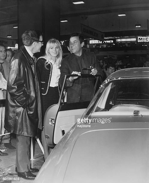 British comic actor Peter Sellers his wife Swedish actress Britt Ekland and American actor Tony Curtis with a Ferrari 500 Superfast coupe which...