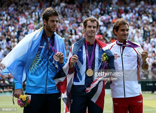 Left to right bronze medallist Juan Martin del Potro of Argentina gold medallist Andy Murray of Great Britan and silver medalist Roger Federer of...