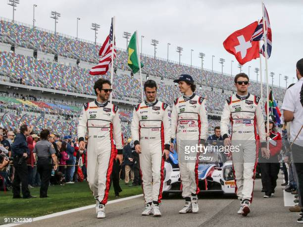 Left to Right Bruno Senna of Brazil Will Owen Hugo de Sadeleer of Switzerland and Paul di Rest of Great Britain walk on the grid before the start of...