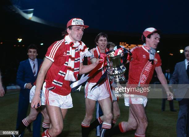 Left to right Bryan Robson Arnold Muhren and Frank Stapleton with the FA Cup after the FA Cup Final replay between Brighton and Manchester United...