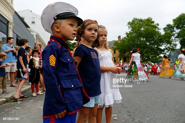 Left to right Calvin Albrecht Catherine Foster and Emme Kate Albrecht all of Hamilton watch the Fourth of July Parade in Manchester By The Sea Mass...