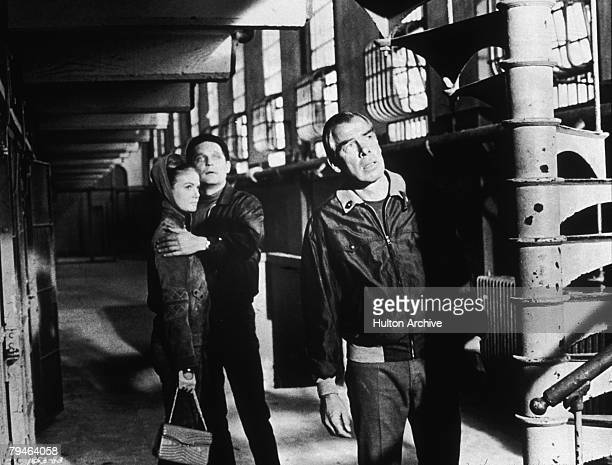Canadian actors Sharon Acker and John Vernon with American actor Lee Marvin in a scene from the thriller 'Point Blank' directed by John Boorman 1967
