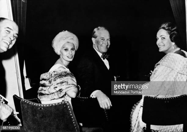 Left to right Carlo Ponti italian film producer and his wife Sophia Loren italian actress Maurice Chevalier french actor and singer Begum Om Habibeh...