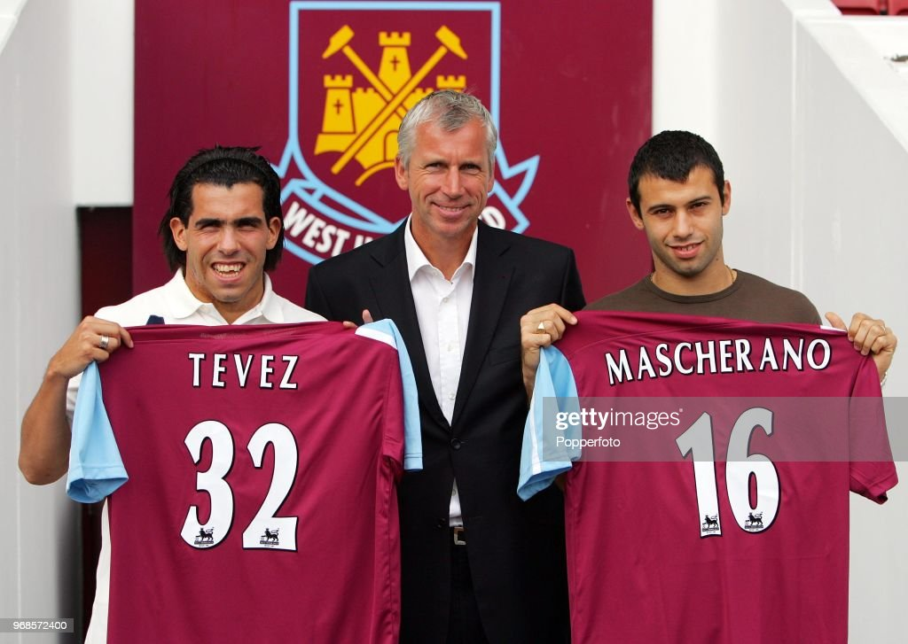Left to right, Carlos Tevez, West Ham manager Alan Pardew and Javier Mascherano pose with their squad numbers during a West Ham United press conference to unveil the new signings at Upton Park in London on September 5, 2006.