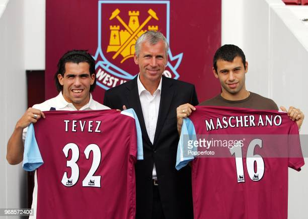 Left to right Carlos Tevez West Ham manager Alan Pardew and Javier Mascherano pose with their squad numbers during a West Ham United press conference...