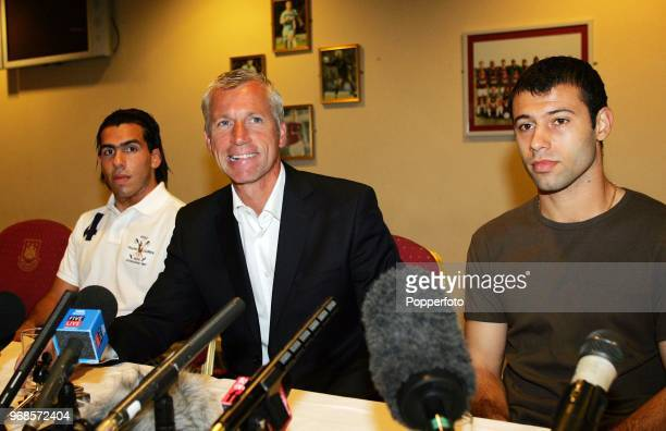 Left to right Carlos Tevez West Ham manager Alan Pardew and Javier Mascherano during a West Ham United press conference to introduce the new signings...