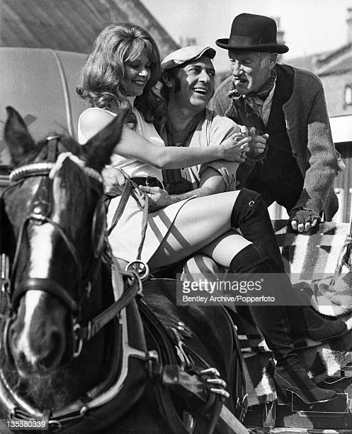 Carolyn Seymour Harry H Corbett and Wilfrid Brambell on the set of the film 'Steptoe and Son' London 8th October 1971 The film a spinoff from the...