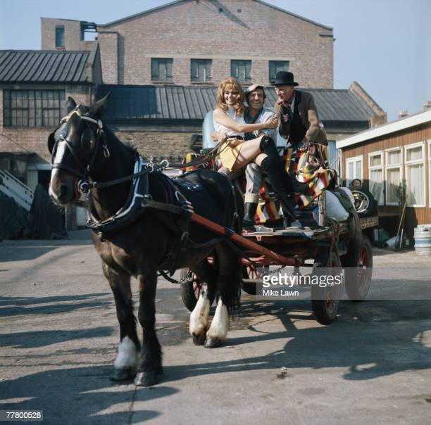 Carolyn Seymour Harry H Corbett and Wilfrid Brambell during filming of the comedy 'Steptoe And Son' directed by Cliff Owen 1971