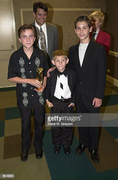 Left to right cast members of Malcolm in the Middle Frankie Muniz Erik Per Sullivan and Justin Berfield pose for photographers at the first ever West...
