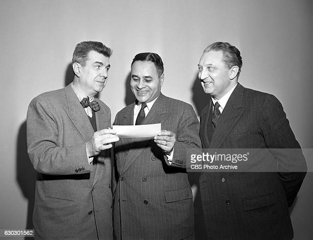 Left to right CBS television personality Ken Murray 1950 Nobel Peace Prize winner Dr Ralph Bunche and Leon Steinig a director at the United Nations...