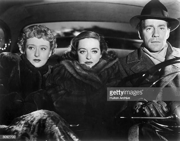 Celeste Holm, Bette Davis and Hugh Marlowe take a bumpy car ride together in the 20th Century Fox film 'All About Eve', 1950. The film won Joseph L...