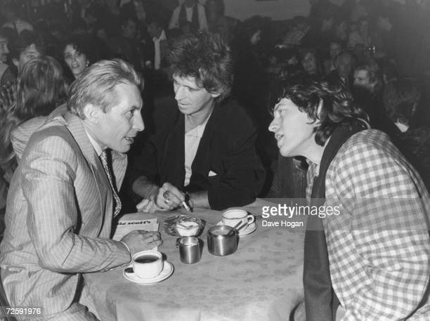 Left to right; Charlie Watts, Keith Richards and Mick Jagger of The Rolling Stones at Ronnie Scott's in London, 18th November 1985. Watts is...