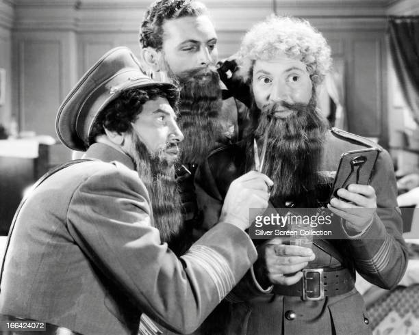 Left to right Chico Marx Allan Jones and Harpo Marx disguise themselves with stolen beards in a scene from the Marx Brothers' comedy 'A Night At The...