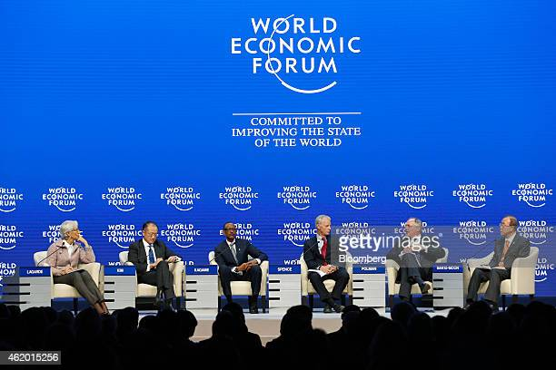Left to right Christine Lagarde managing director of the International Monetary Fund Jim Yong Kim president of the World Bank Group Paul Kagame...