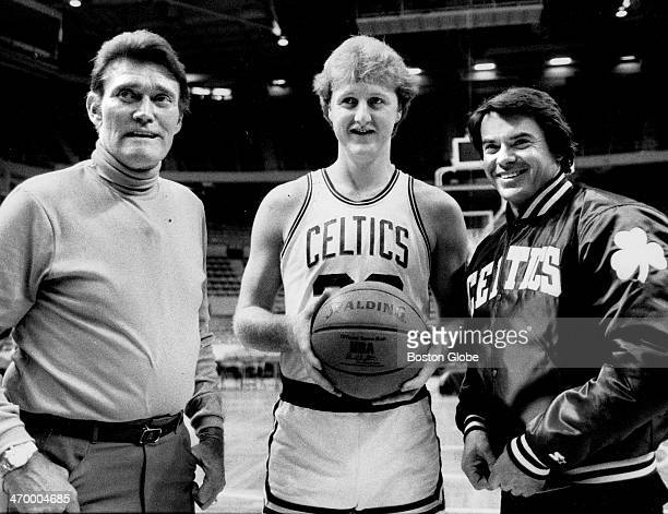 Left to right Chuck Connors Boston Celtics player Larry Bird and Robert Urich at Boston Garden on Jan 25 1985