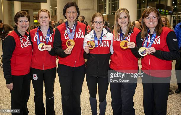 Left to right, coach Janet Arnott, lead Dawn McEwen, second Jill Officer, third Kaitlyn Lawes, and skip Jennifer Jones, and alternate Kirsten Wall of...