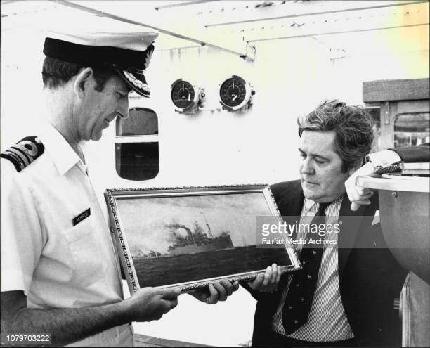 Commander JO Morrice and Capt Owen Thomas with the print from a painting by Montague Dawson of the EnglishHMS Jervis Bay in gallant action against...
