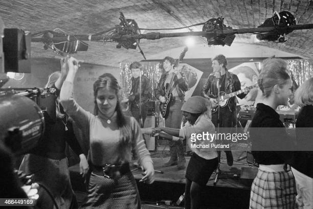 Dave Edmunds David Essex and Paul Nicholas as members of fictional rock group The Stray Cats during the filming of 'Stardust' directed by Michael...