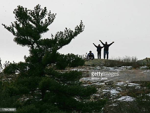 Left to right David Samuelson Keith Allison and David's father Ed Samuelson stand on top of Eagle Rock overlooking Pearce Lake and the Breakheart...