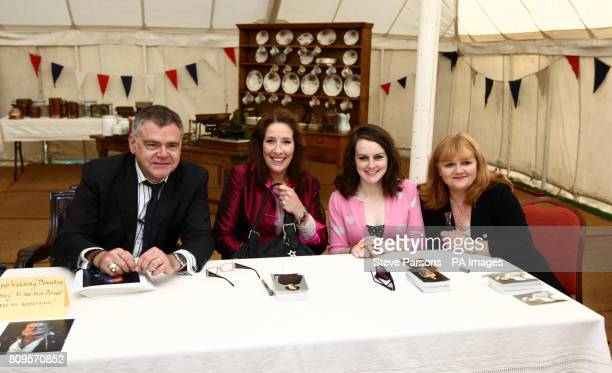 Left to right Downton Abbey's Kevin McNally Phyllis Logan Sophie McShera and Lesley Nicol signing autographs at the Heroes at Highclere charity...
