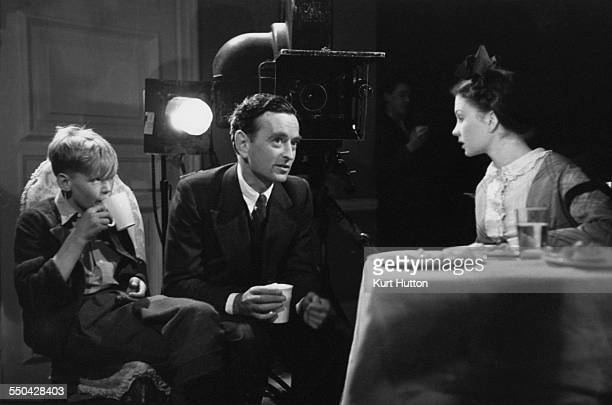 English child actor Anthony Wager with English film director David Lean and actress Jean Simmons during a screen test for the role of the young Pip...