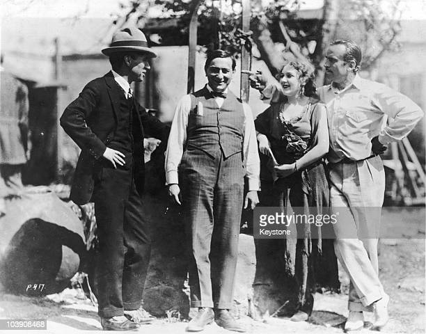 English comic actor Charlie Chaplin , director Ernst Lubitsch , actress Mary Pickford and actor Douglas Fairbanks Sr , USA, circa 1917.