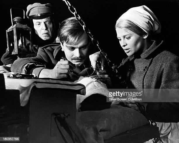 Erik Chitty as Old Soldier Omar Sharif as Doctor Yuri Zhivago and Julie Christie as Lara Antipova in 'Doctor Zhivago' directed by David Lean 1965
