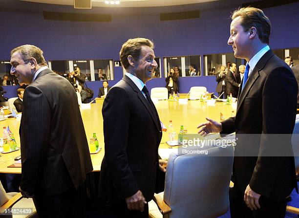 Left to right Essam Sharaf Egypt's prime minister Nicolas Sarkozy France's president and David Cameron UK prime minister attend a round table...