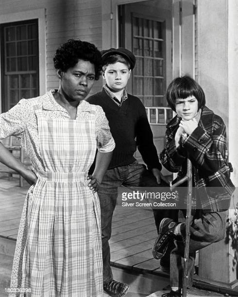 Estelle Evans as Calpurnia Phillip Alford as Jem and Mary Badham as Scout in 'To Kill A Mockingbird' directed by Robert Mulligan 1962