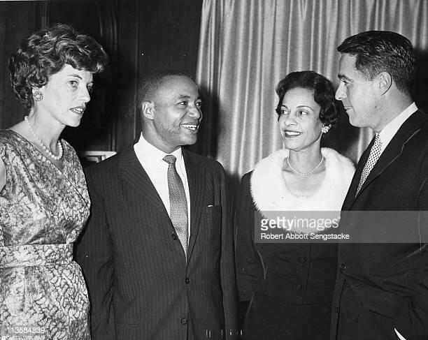Left to right Eunice Kennedy Shriver Chicago Defender publisher John H Sengstacke Myrtle Sengstacke and Sargent Shriver gather together at an...
