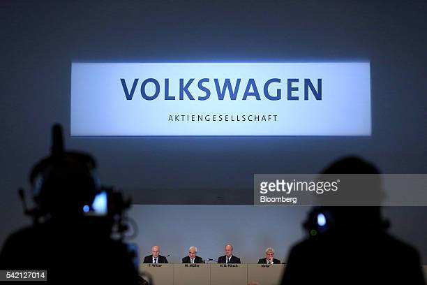 Left to right Frank Witter chief financial officer of Volkswagen AG Matthias Mueller chief executive officer of Volkswagen AG Hans Dieter Poetsch...