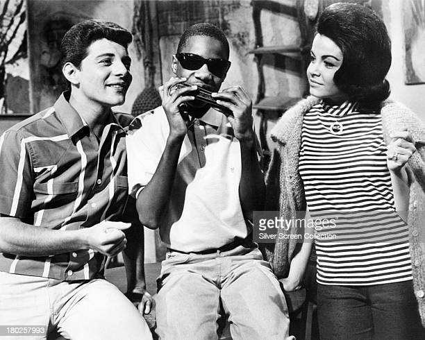 Frankie Avalon as Frankie thirteen yearold singersongwriter Stevie Wonder as himself and Annette Funicello as Dee Dee in 'Muscle Beach Party'...