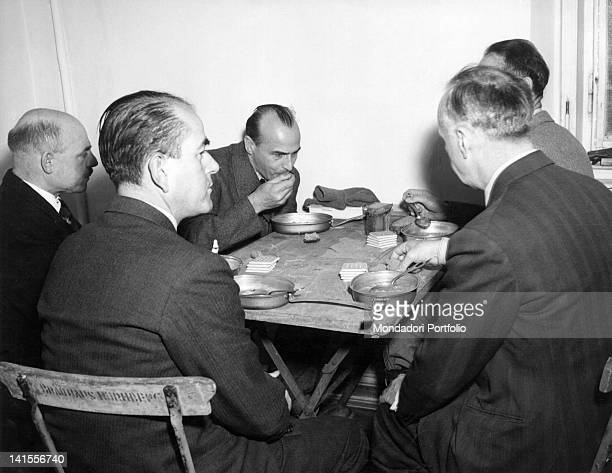 Rudolf Hess Joachim von Ribbentrop Hans Frank Fritz Sauckel and Albert Speer defendants at the Nuremberg trial having lunch in the prison refectory...