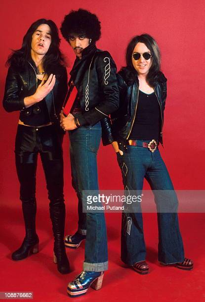 Gary Moore Phil Lynott and Brian Downey of Thin Lizzy pose for a studio group portrait in London in 1974