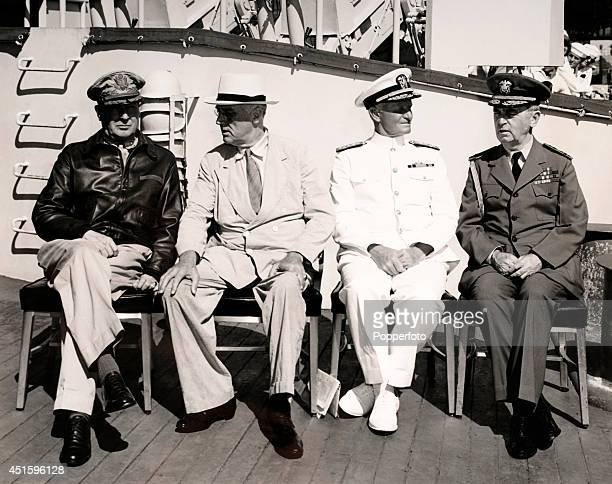 Left to right General Douglas MacArthur President Franklin Roosevelt Admiral Chester Nimitz and Admiral William Leahy on board the USS Baltimore at...