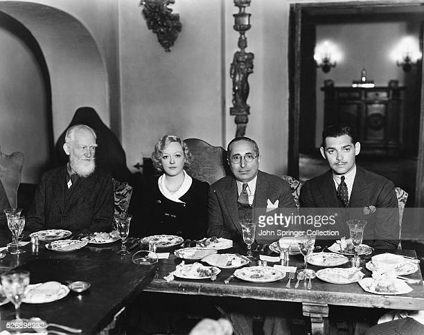 George Bernard Shaw Marion Davies Louis B Mayer and Clark Gable seated at a banquet table during a luncheon given for Mr Shaw