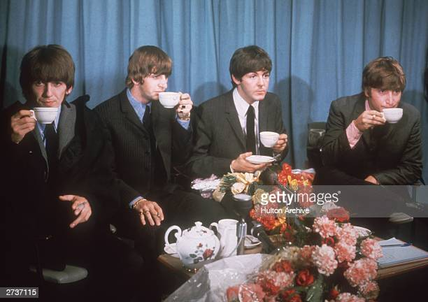 George Harrison Ringo Starr Paul McCartney and John Lennon of The Beatles at a press conference at London Airport 2nd July 1964 following a tour of...