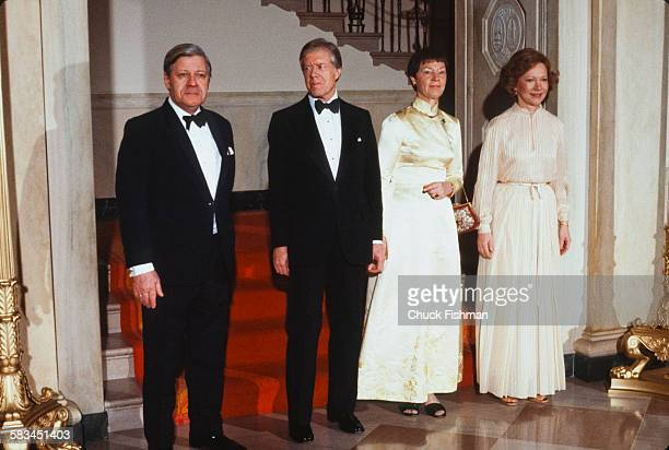 Left to right, German Chancellor Helmut Schmidt, American President Jimmy Carter, Schmidt's wife Loki, and First Lady Rosalynn Carter attend a White...