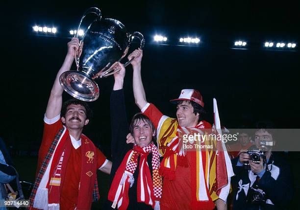 Graeme Souness Kenny Dalglish and Alan Hansen of Liverpool with the European Cup after their 10 win over Real Madrid in the European Cup Final at the...