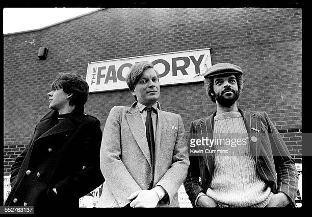 graphic designer Peter Saville with Factory Records founders Tony Wilson and Alan Erasmus outside the Russell Club in Royce Road Hulme Manchester...