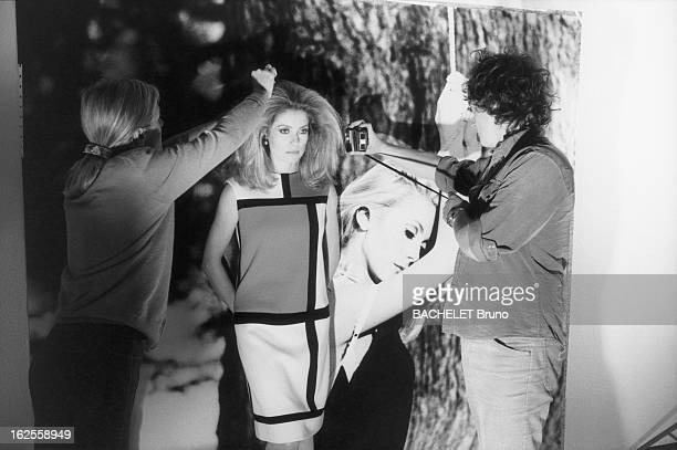 Left to right hairdresser Edina Vabre French actress Catherine Deneuve and Dominique Olida assistant to German photographer Helmut Newton during a...